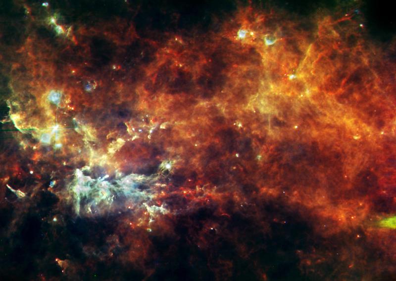 Chaîne de production d'étoiles dans la constellation du Petit Renard. Crédits: ESA/Hi-GAL Consortium.