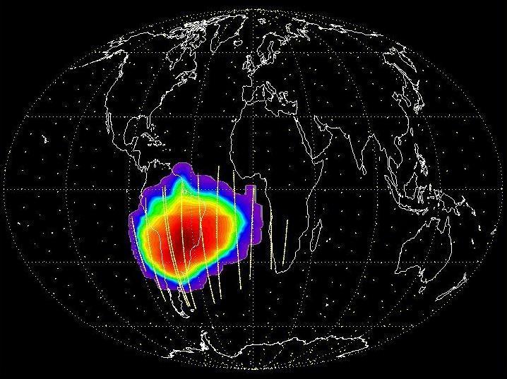 Cartographie du flux de proton perçu par les CCDs Corot derrière blindage. La trajectoire du satellite est représentée en jaunes. On y voit les 8 passages par l'anomalie.